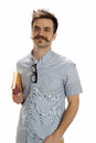 Book walker handsome young man with a handlebar mustache and hipster glasses holds an old Royalty Free Stock Photo