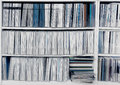 Bookcase with publications Royalty Free Stock Photo