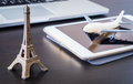 Booking Plane ticket online to Paris France using Tablet. Royalty Free Stock Photo
