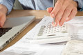 Bookkeeping with Calculator, Pen and Laprop Computer Royalty Free Stock Photo