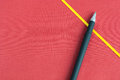 Bookmark and pen golden black on red background Stock Photo
