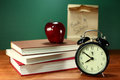Books apple and lunch on teacher desk back to school Royalty Free Stock Photo