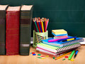Books and blackboard. School supplies. Royalty Free Stock Photos