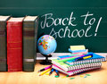 Books and blackboard. School supplies. Stock Photo