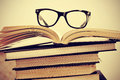Books and eyeglasses picture of a pile of with a retro effect Royalty Free Stock Images