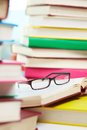 Books and glasses vertical image of eyeglasses lying over opened book in the library Royalty Free Stock Photo