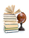 Books and globe isolated on white background vintage a vertical photo Stock Photos
