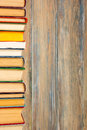 Books on grunge wooden table desk shelf in library. Back to school background, copy space for your ad text. Old hardback Royalty Free Stock Photo