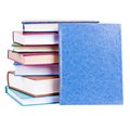 Books heap isolated colorful and blue book with hardcover standing before them on white Royalty Free Stock Photos
