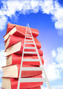 Books and ladder on background with blue sky white clouds Stock Photos