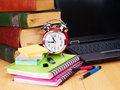 Books and laptop school supplies back to Royalty Free Stock Photo