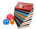 Books and a magnifier Royalty Free Stock Images