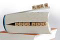 Books and message for story writers show don t tell creative writing spelled with wooden letter blocks on the top between pages of Stock Images