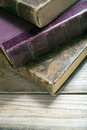 Books old book over a rustic wooden table Stock Images