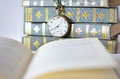 Books with old watch reading time open book in front of an Royalty Free Stock Photography