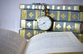 Books with old watch reading time open book in front of an Royalty Free Stock Photos