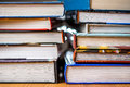 Books a pile of hardback on a wooden table Royalty Free Stock Images