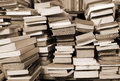 Books piled up for sale in the great library Royalty Free Stock Photo