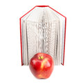 Books and red apple on white background Stock Photos