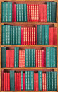 Books on the shelf red and green wallpaper Royalty Free Stock Photo