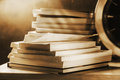 Books stack on desk sepia tone Stock Image