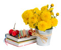 Books and yellow mums flowers on white back to school concept Royalty Free Stock Photo