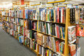 Bookstore aisle art books of a with on and artists lining bookshelves large bookstores such as this one can be found in every mall Royalty Free Stock Photo