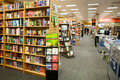 Bookstore asile aisle of a with books lining bookshelves and bins of books on sale large bookstores such as this one can be found Royalty Free Stock Photo