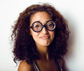 Bookworm cute young woman in glasses close up Stock Images