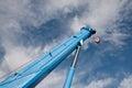 Boom truck crane raised ton against the sky Stock Image
