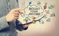Boost your income concept with tablet computer young man pointing at over a Royalty Free Stock Photo