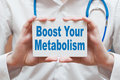 Boost your metabolism card with text in doctor hands Royalty Free Stock Photos