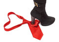 Boot steps on a necktie red symbolising woman dominating over man tie shape of heart Stock Photography