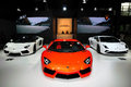 The booth of lamborghini supercars guangzhou china november aventador lp roadster aventador lp and gallardo lp noctis were Stock Image