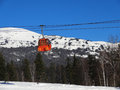 Booth of the ski lift against mountains and blue sky russia sheregesh Royalty Free Stock Photos
