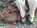 Boots and backpack a man s walking with resting beside them ready for the hike Stock Image