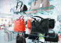 Boots bags in a fashion store Royalty Free Stock Images