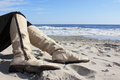 Boots on the beach Royalty Free Stock Photo