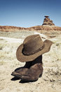 Boots and hat in front of mexican hat usa Royalty Free Stock Photography