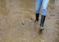 Boots in the mud of the flood after natural disaster black Stock Image
