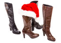 Boots and santa hat with white background Royalty Free Stock Photo
