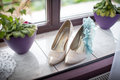 Boots on the windowsill and garter Royalty Free Stock Photo
