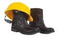 Boots yellow hard hat over white background small natural shadow under boots Royalty Free Stock Photos