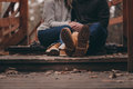 Boots of young couple walking outdoor on wooden bridge in autumn Royalty Free Stock Photo