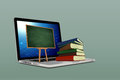 Bord and book with laptop on background green Royalty Free Stock Photos