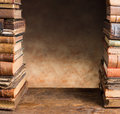 Border with antique books frame image of two stacks of Stock Image