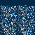 The border of delicate little blue and white flowers on navy blue background from above. Flat lay style.