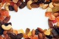 Border of dried fruits and nuts Royalty Free Stock Photo