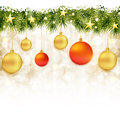 Border of fir twigs with Christmas ornaments Royalty Free Stock Images