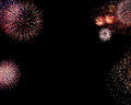 Border of fireworks or frame composed colorful firework flashes isolated on black background with empty copyspace in the middle to Stock Image